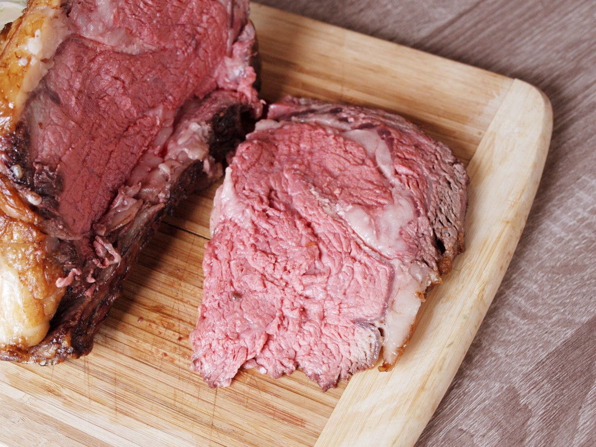 When you are ready to slice, carefully cut the roast away from the rack of bones. Then, measure the length of the roast and divide those inches by the number of people eating and slice the roast into evenly thick slices.