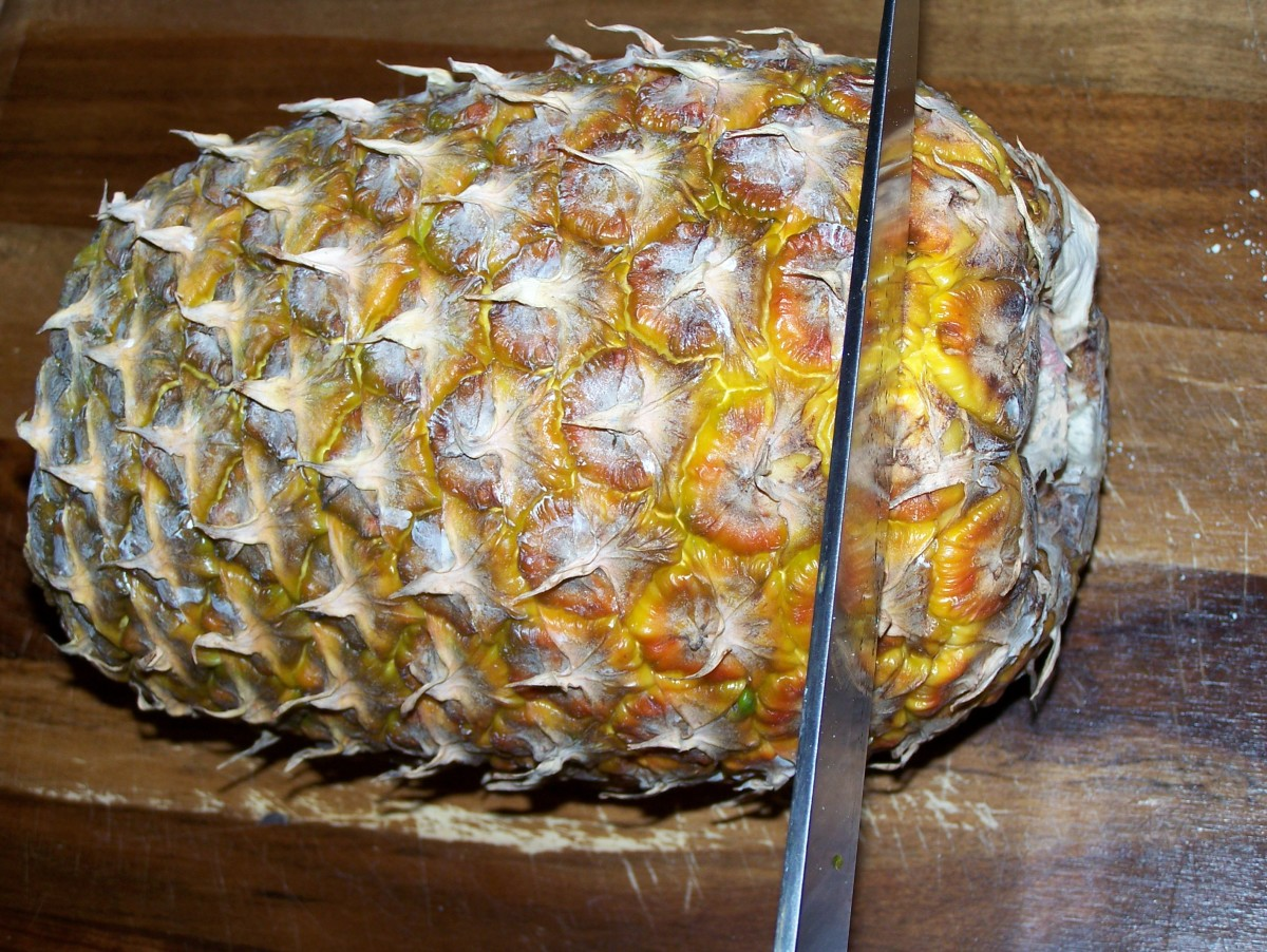 Step Four: Cut off the bottom of the pineapple, leaving you with a cylinder shape that can easily stand on end.