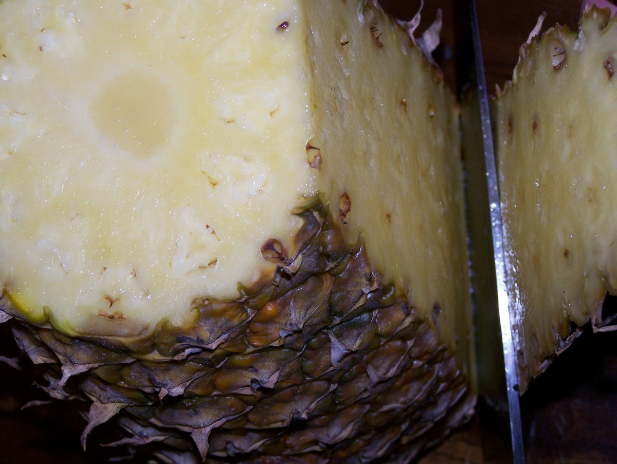 Step 5: De-skin the pineapple by slicing thinly under the skin to the light yellow yummy part.