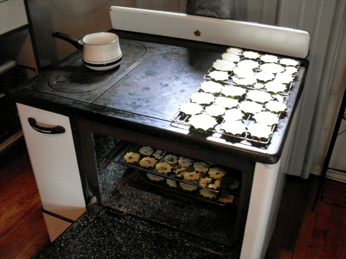 An old-fashioned cookstove is superb for drying vegetables. I have one load on top on the just-warm side, starting the process, and a tray inside, almost finished.