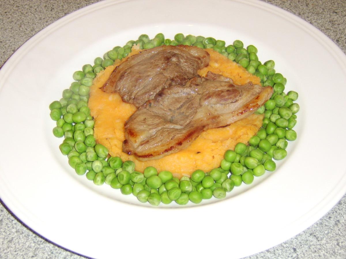 Grilled Leg of Lamb Steak on Sweet Potato and Garlic Mash