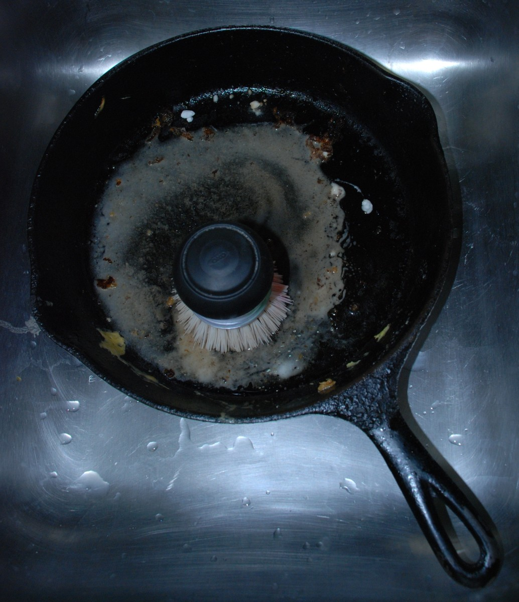 Scrubbing the baking soda-water mixture into the pan with a strong brush will help break down burnt food and other residue.