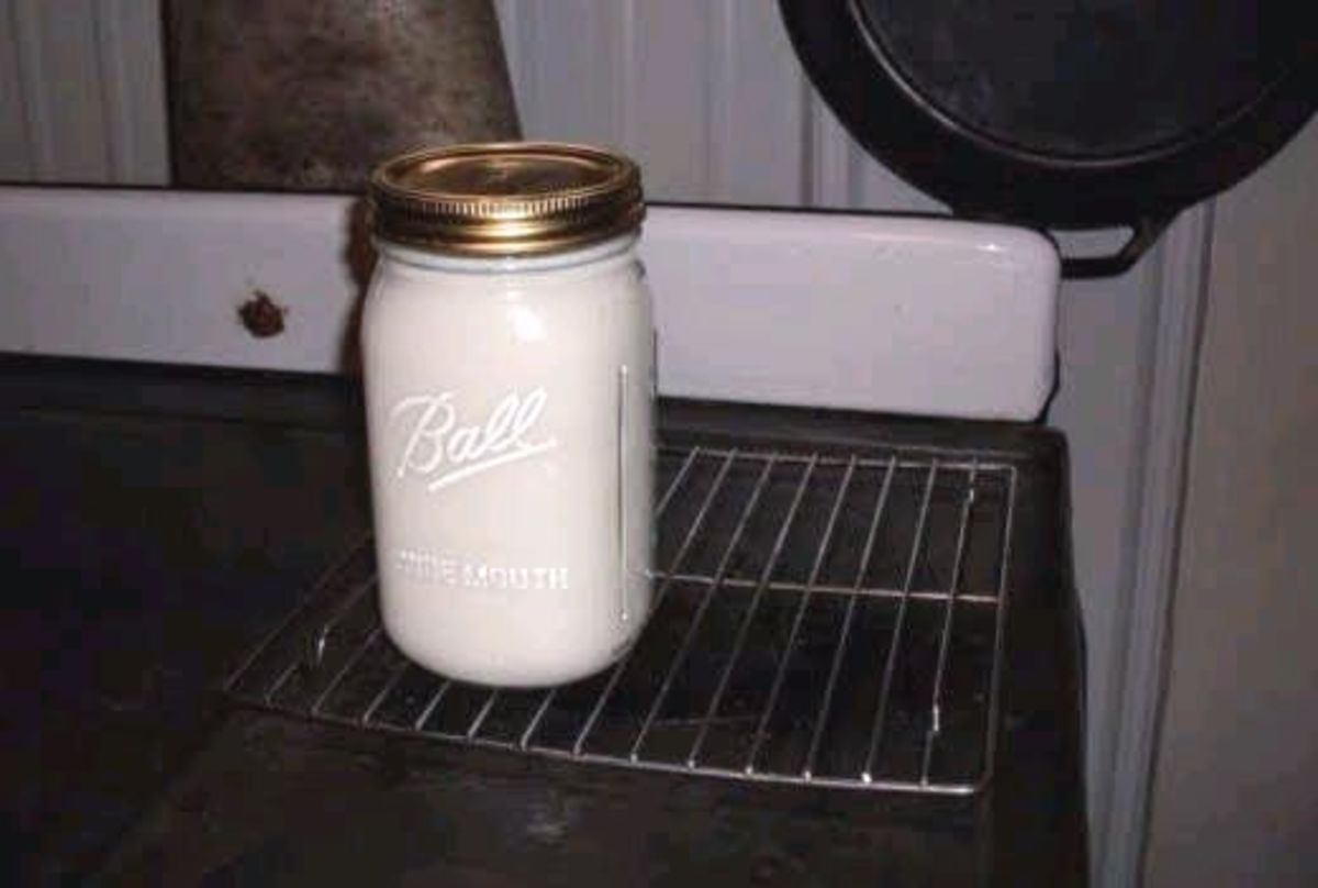 The jar can sit close to the stove, but must not touch it or it will break. A baking rack is ideal.