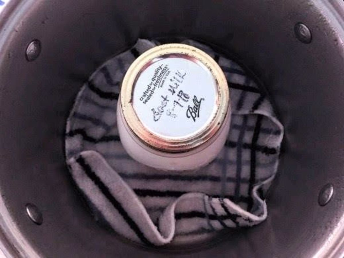A 2-gallon stock pot with a cloth in the bottom works well, if set over very low heat.