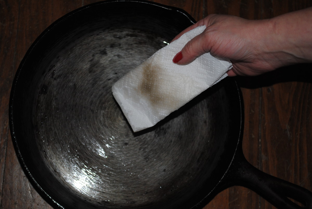Keep wiping down with fresh oil and clean paper towels, and you'll get it REALLY clean.