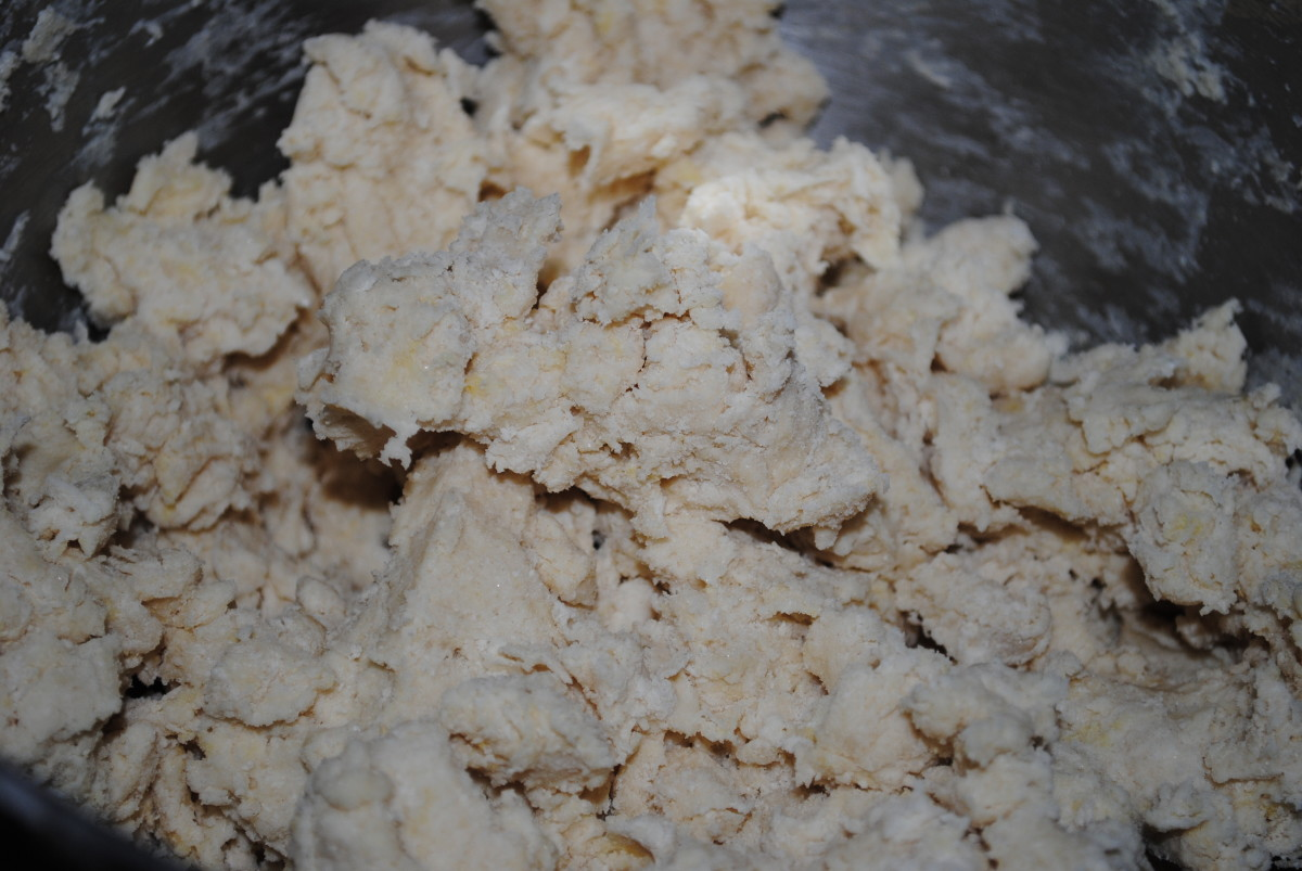 Once the egg and buttermilk are added - the dough will begin to come together. If you're using a mixer, stop when it looks like this. Here is where you begin to knead.