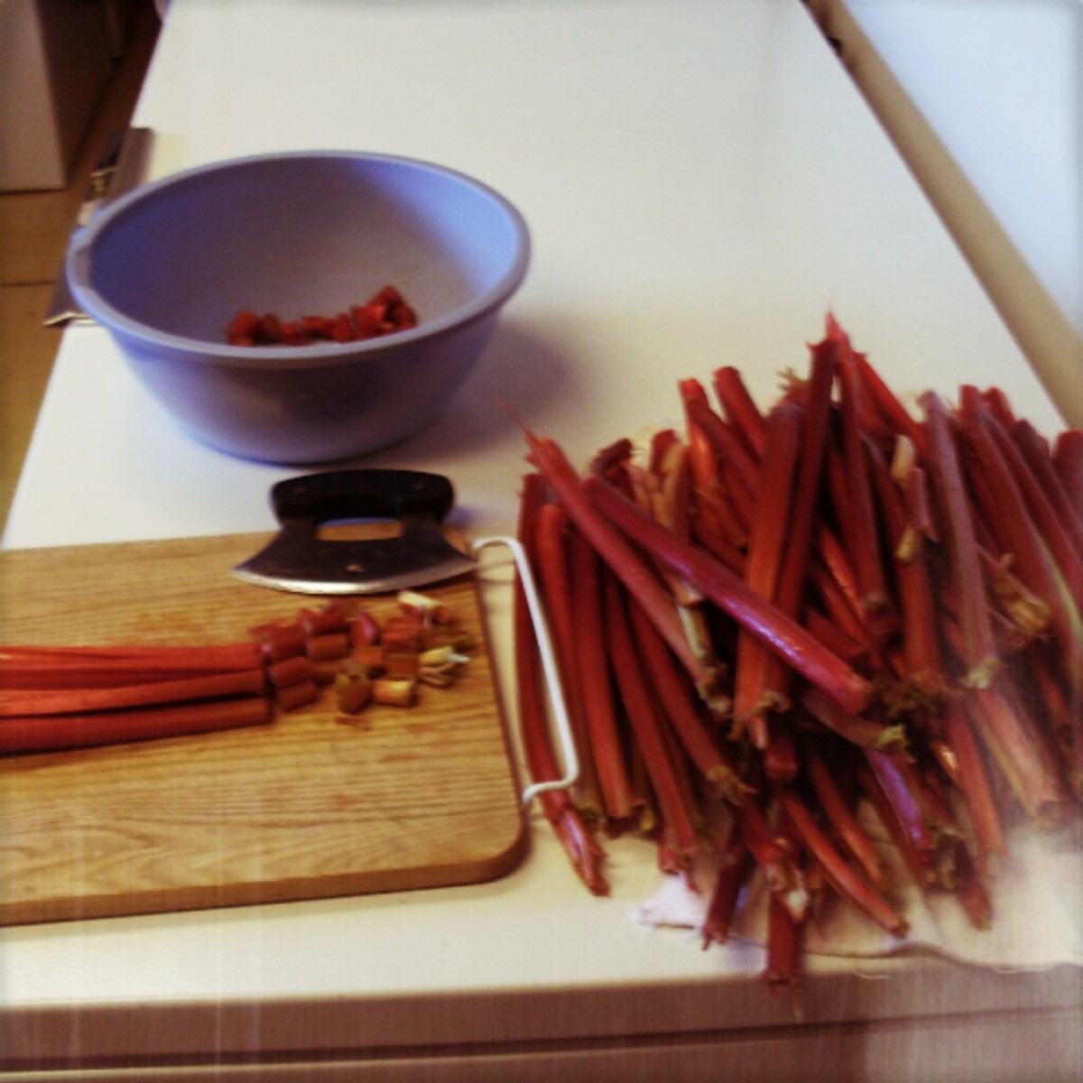 "Rhubarb is largely water and may usually be chopped coursely, as it cooks down a lot. 1/2"" pieces are good for pies, 1/4"" for cakes or breads. Split thick stalks lengthwise, then lay 3 or 4 together, and chop. Peel only as necessary."
