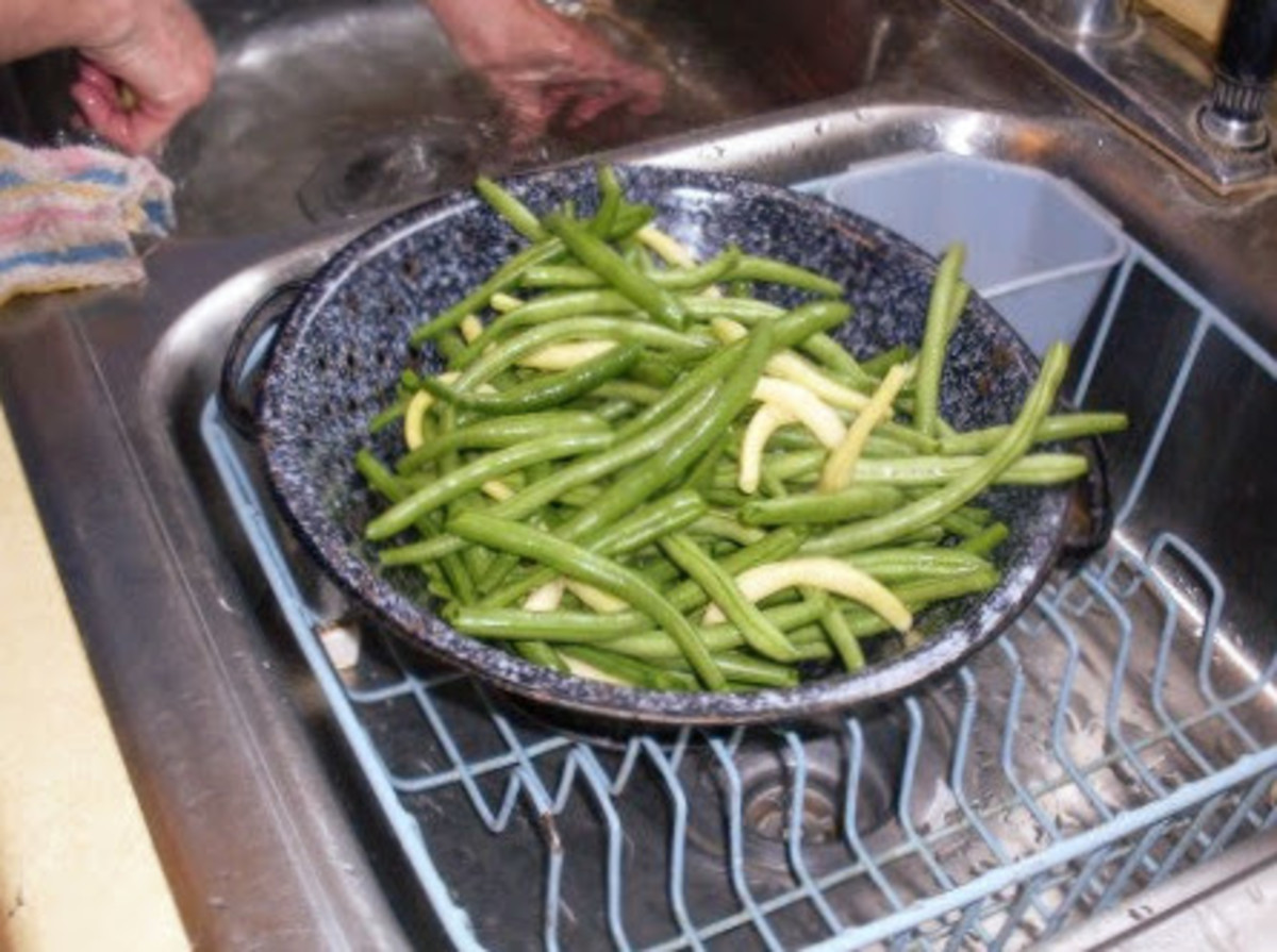 Drain them for a few minutes. It is best to prepare no more beans than you can put in your canner at one time.