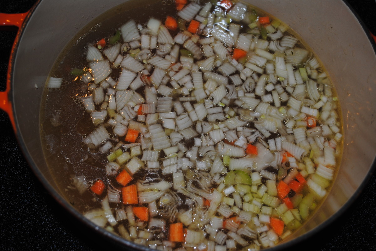 After the broth has been strained, return it to the pot. Add onion, celery and carrot.