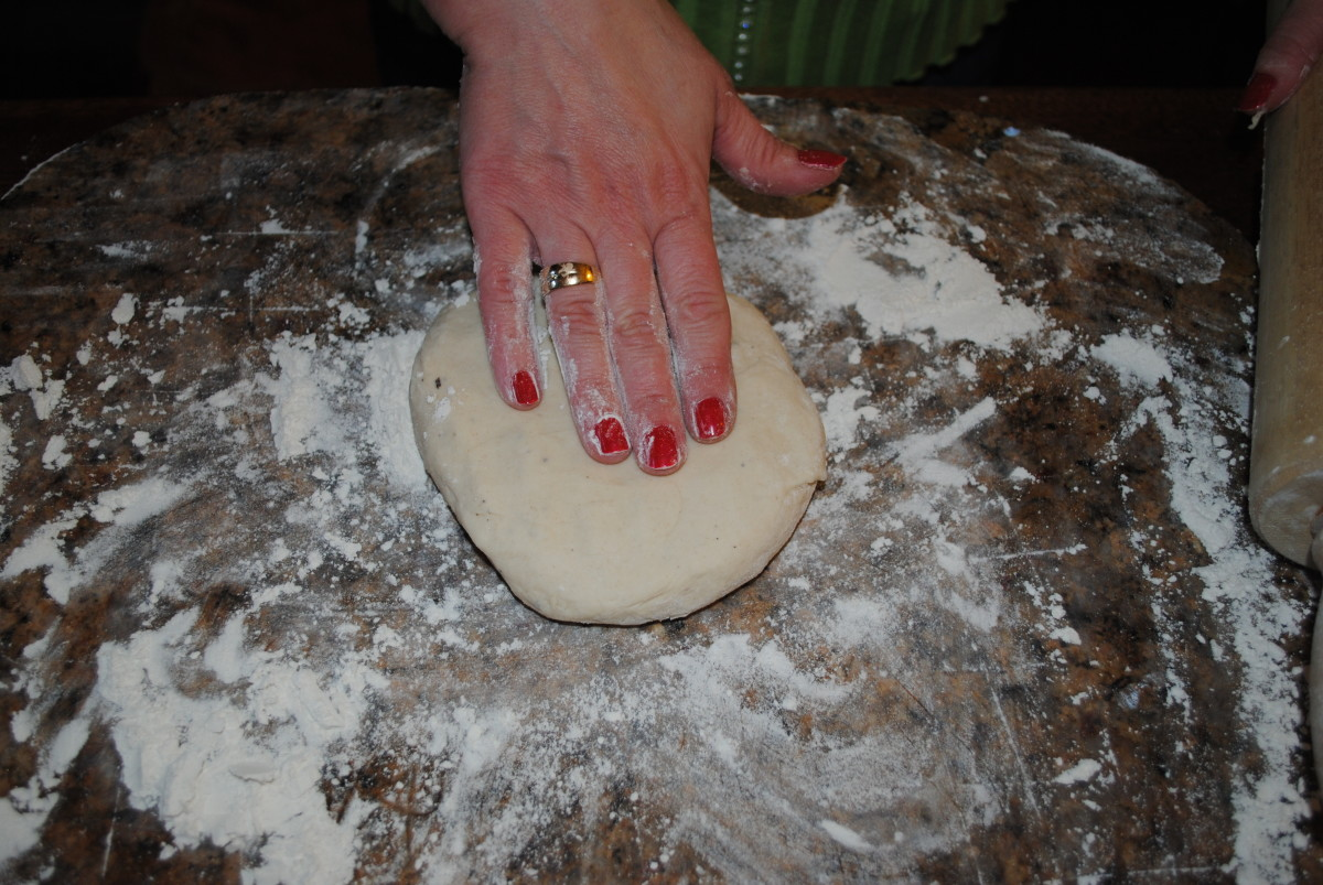 On a floured surface, pat the dough into a disk. I divide the dough into two batches. It's just a little easier to work with.