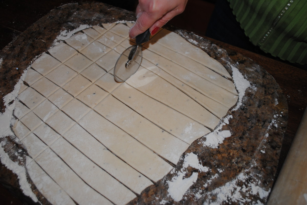Use a knife or pizza cutter to cut the dough into small squares. Strips are fine too.