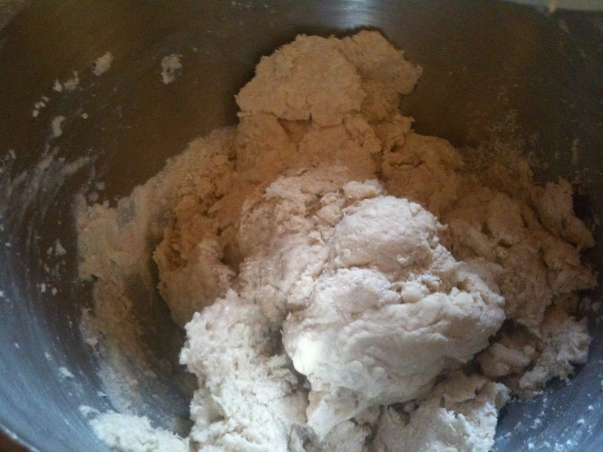 The dough will be rough at first. If it doesn't come together after a minute add a tablespoon of water.