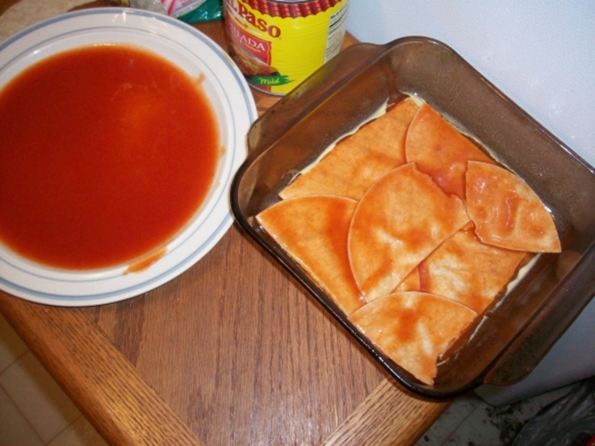 Corn Tortillas Dipped in Enchilada Sauce