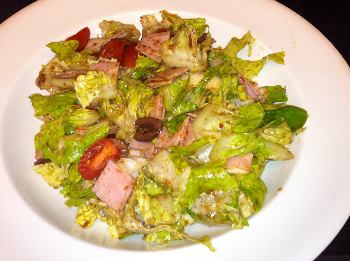 The big arsed salad with romaine, grape tomatoes, kalamata olives, and dressing made with balsamic vinegar.