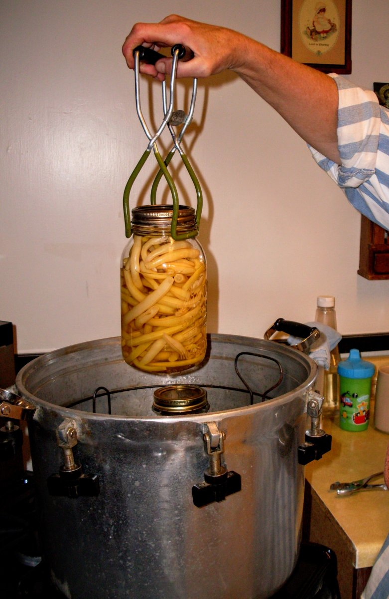 Carefully lift out jars with a jar lifter...