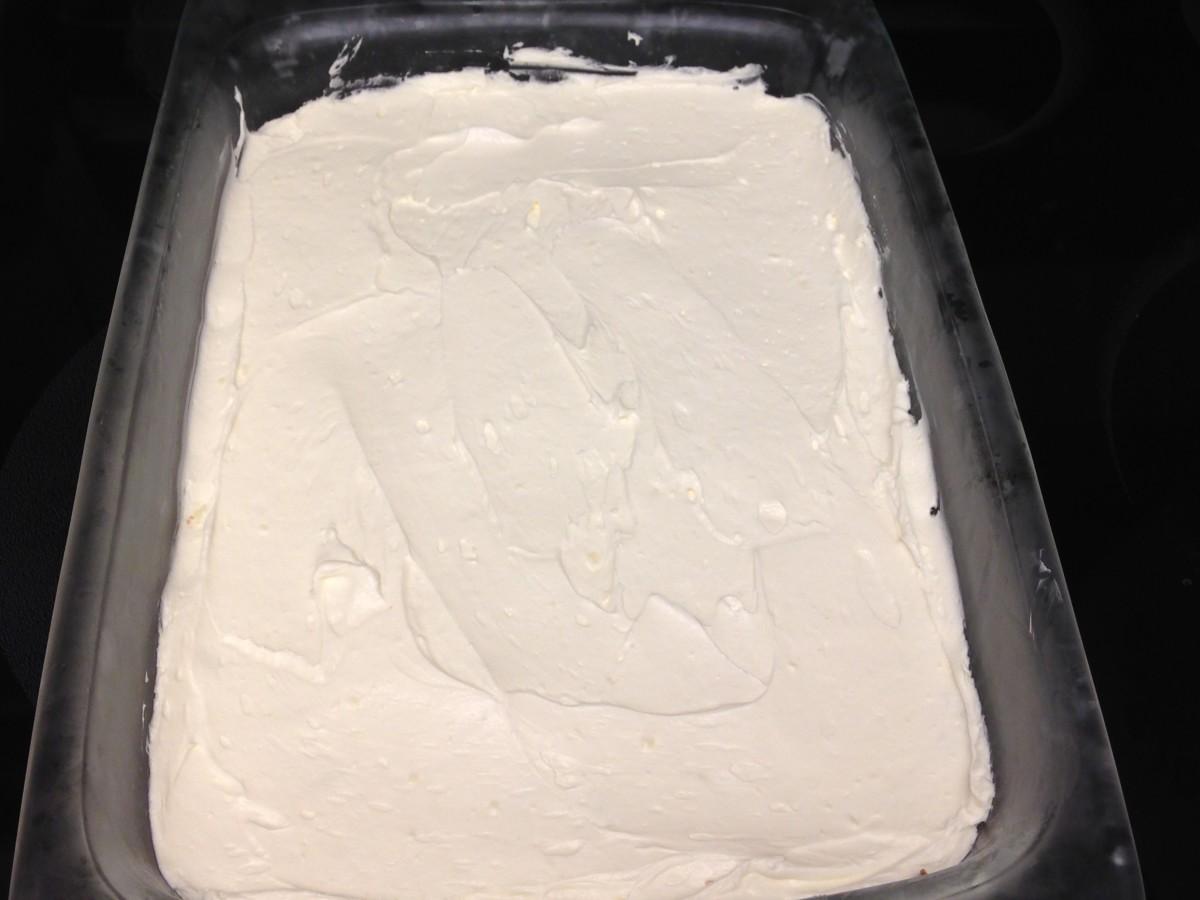 Carefully spread cream cheese mixture on top of pretzel layer