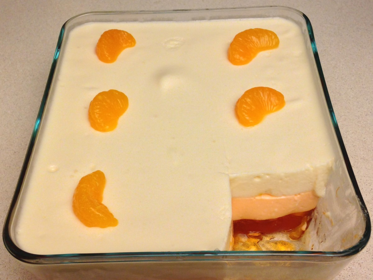 Layered mandarin and lemon dessert decorated with mandarin slices