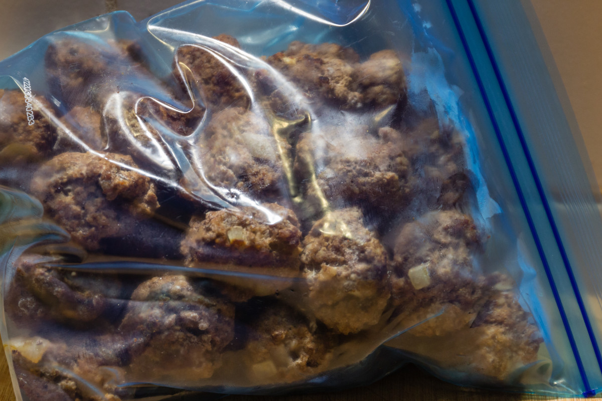 First freeze the meatballs in a single layer so that they don't stick together. Then you can place them all in a bag for storage.