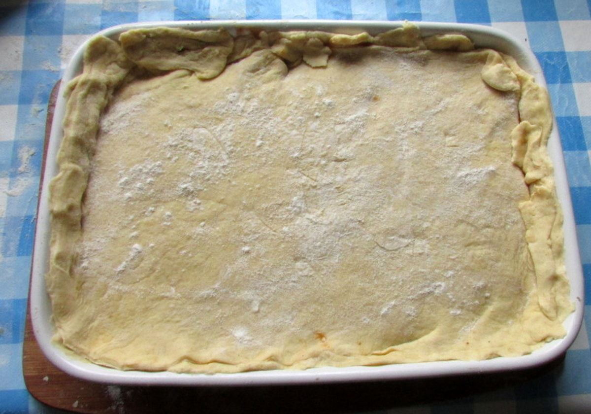 Place the pastry into the dish.