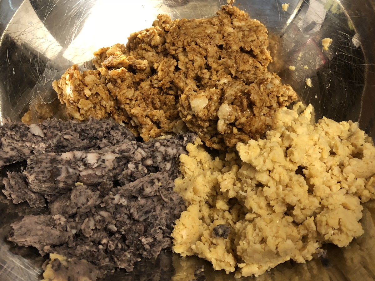 Pulsed black beans, garbanzo beans, and cooked oatmeal with spices mixed in.