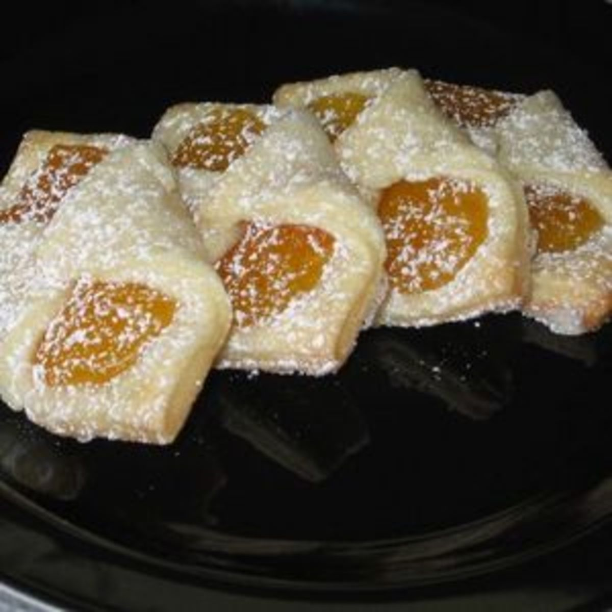 Kolaczki are wonderful butter cookies made with a fruit or cheese filling.