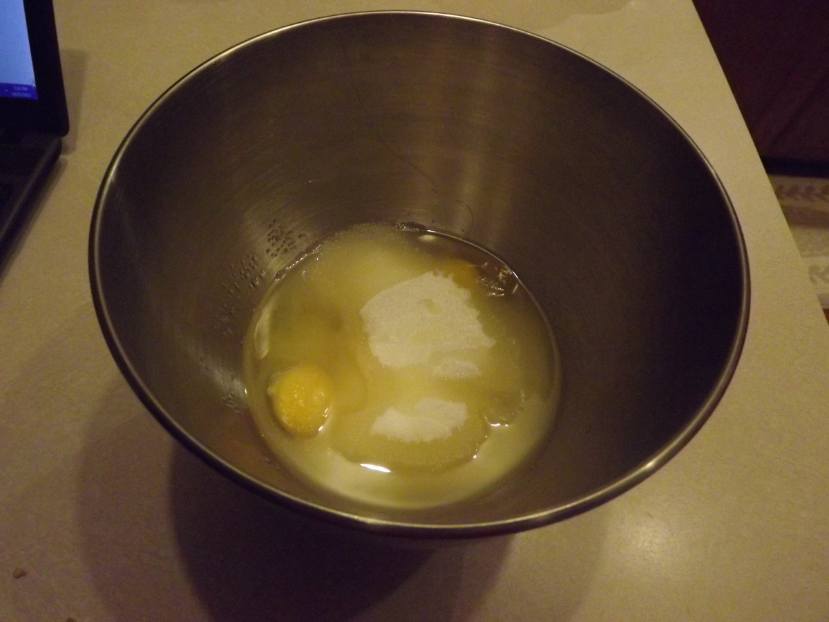 Add the egg, sugar and oil together in a large bowl.