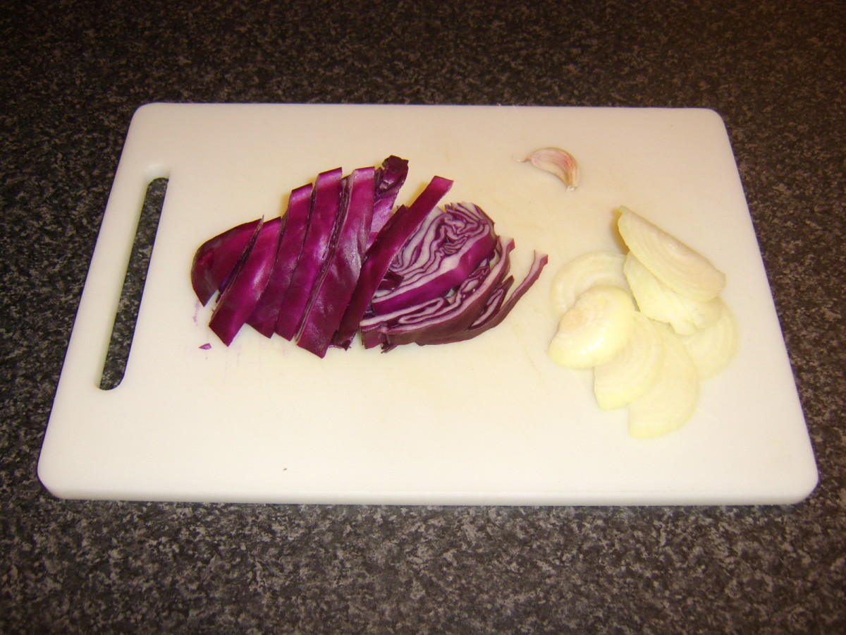 Use the recipe for red cabbage and pear, but substitute 1 small, sliced white onion and 1 large, sliced clove of garlic, as shown here.