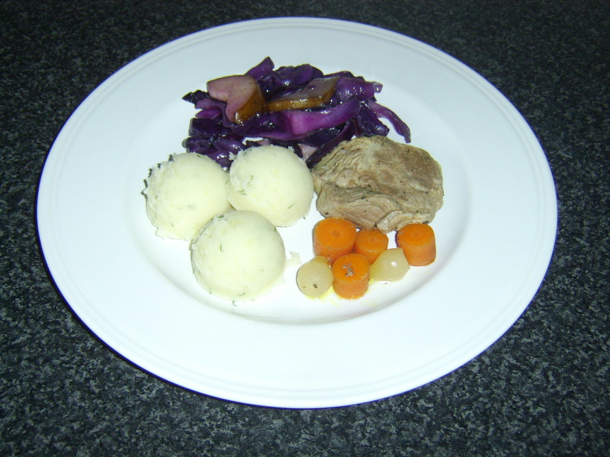 Red cabbage and pear served with casseroled shoulder of pork and mashed potatoes.