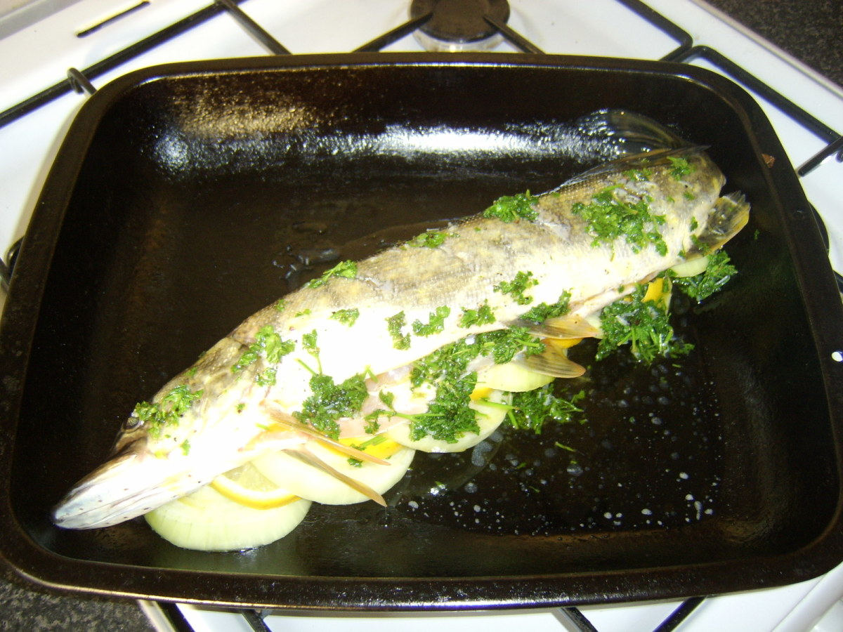 Lemon and Parsley Butter Sauce Poured over Pike