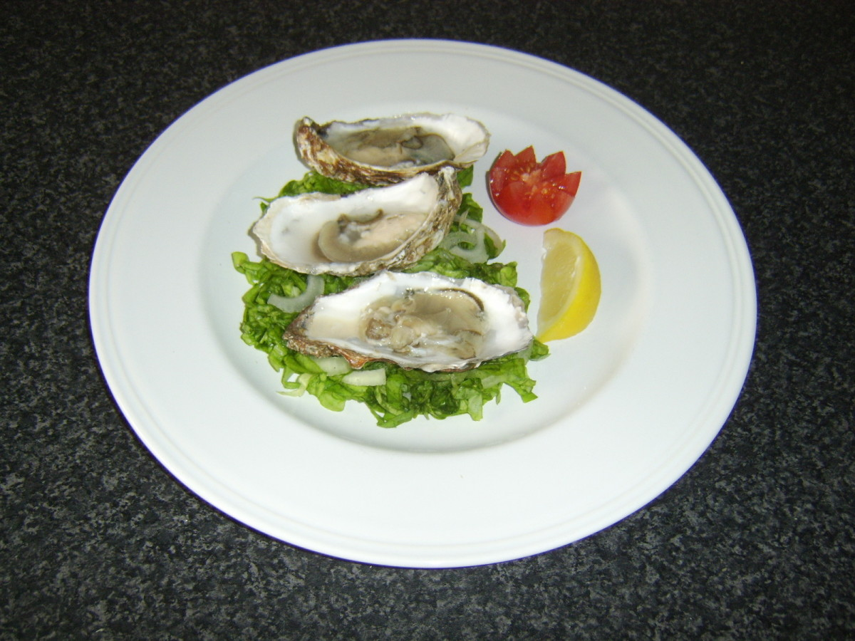 Fresh Oysters with a Simple Salad and Wedge of Fresh Lemon