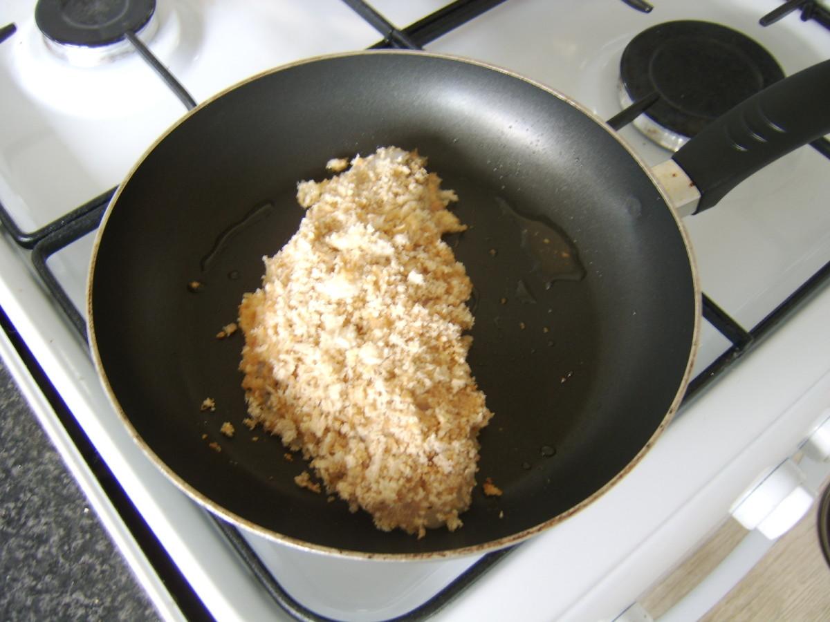 Pouting Fillet in Breadcrumbs in Frying Pan