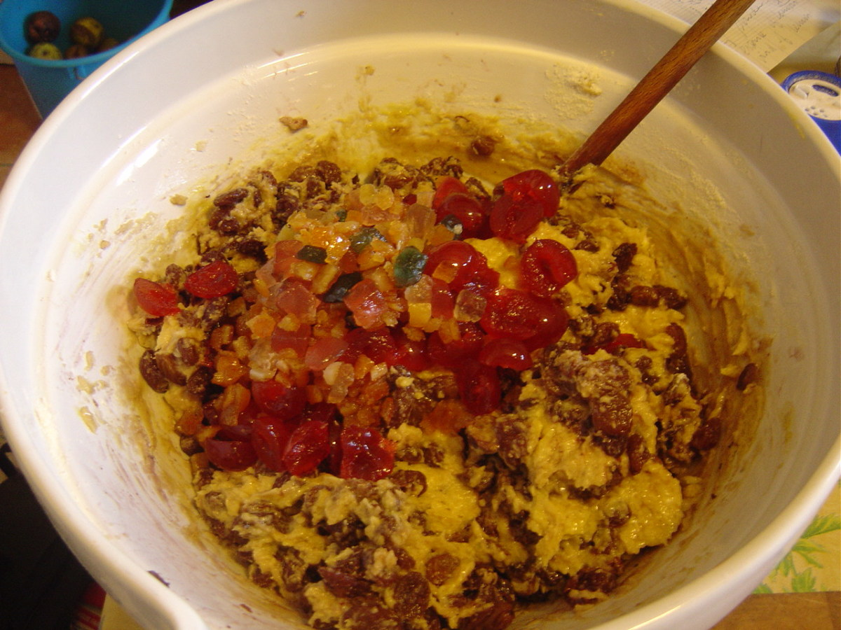 Add eggs, flour, almonds, baking powder, fruit and nuts