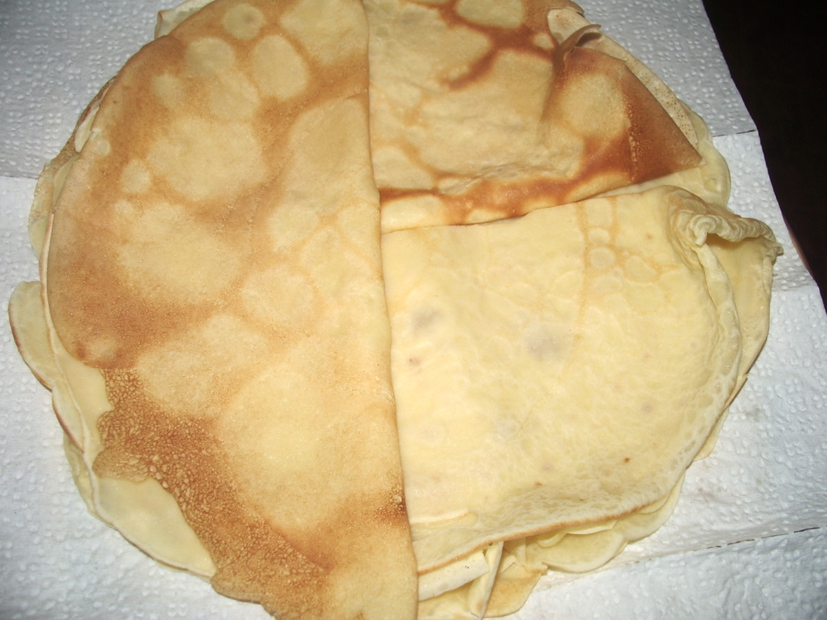 Here is a plate of cooked crepes: folded in half and stacked.