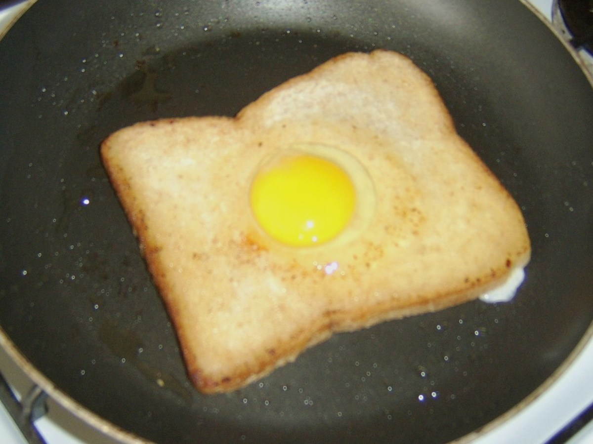 Frying the bread and egg