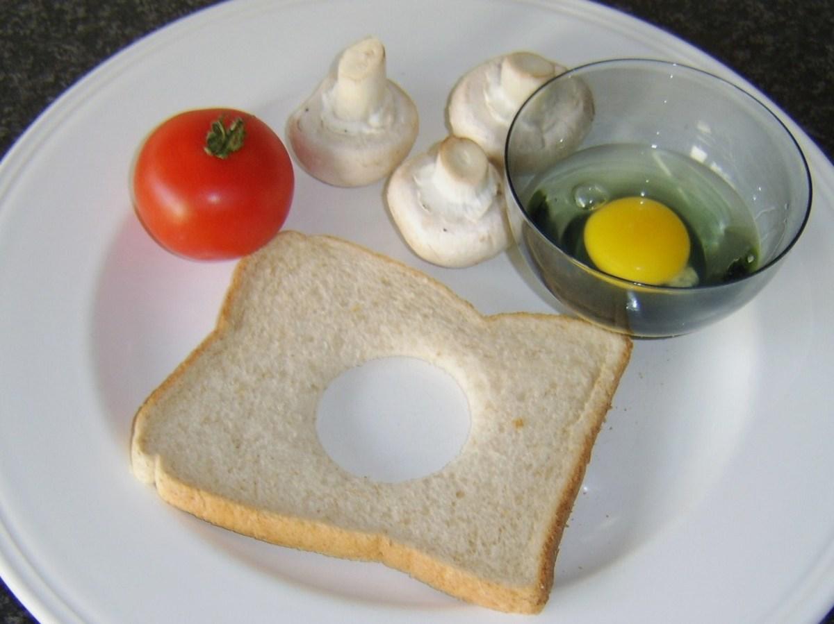 Bread, egg, tomato and mushrooms for full Scottish breakfast