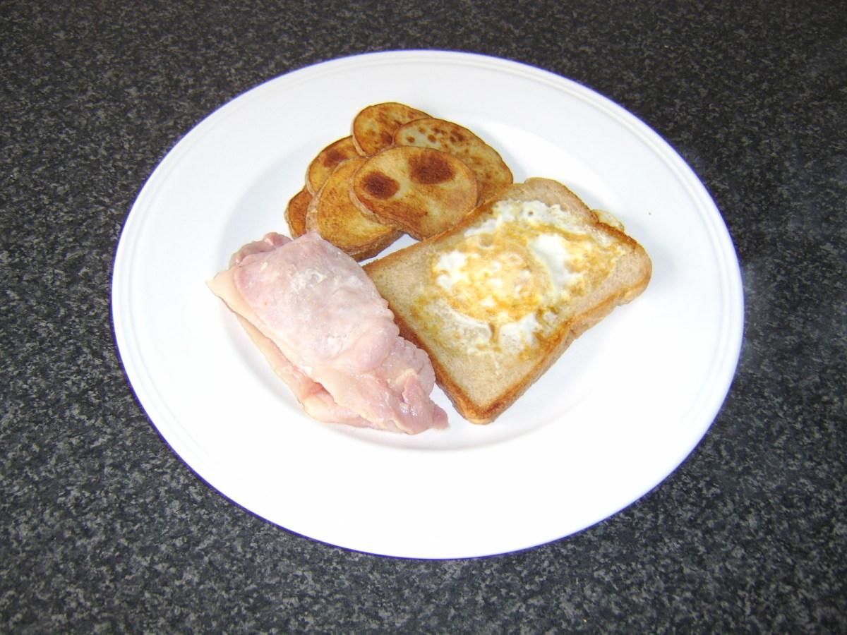 Pan-fried potato slices served with bacon and eggy bread.