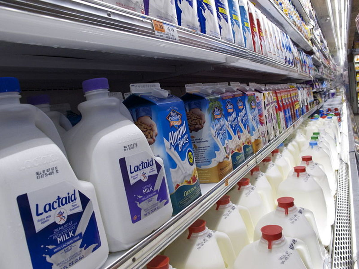 The milk aisle in a grocery store.