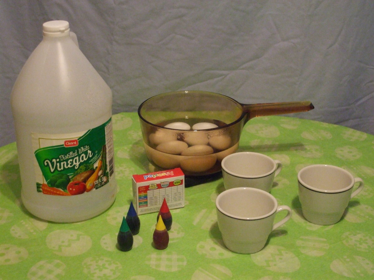 Ingredients and equipment for egg coloring.  I can still remember my Grandma Wilzbach's teacups.