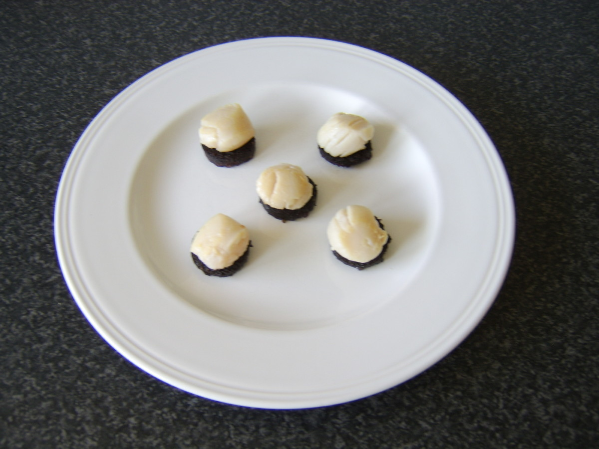 Sit the scallops carefully on top of the slices of black pudding