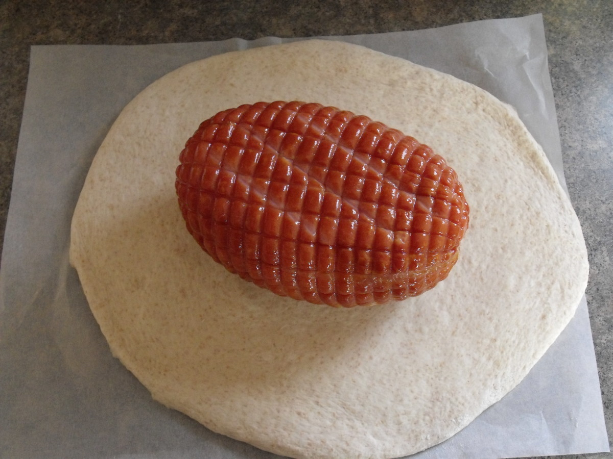 Wrap ham in rolled-out dough