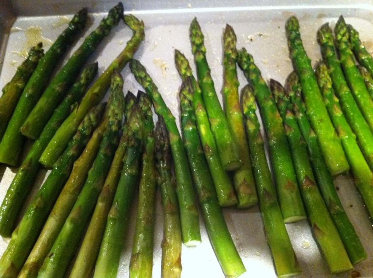 The asparagus on the baking sheet.
