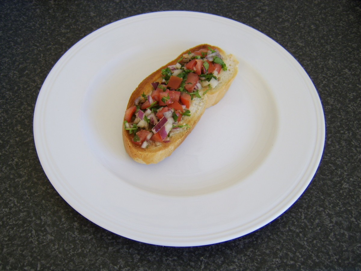 Bruschetta is topped with chopped salad ingredients