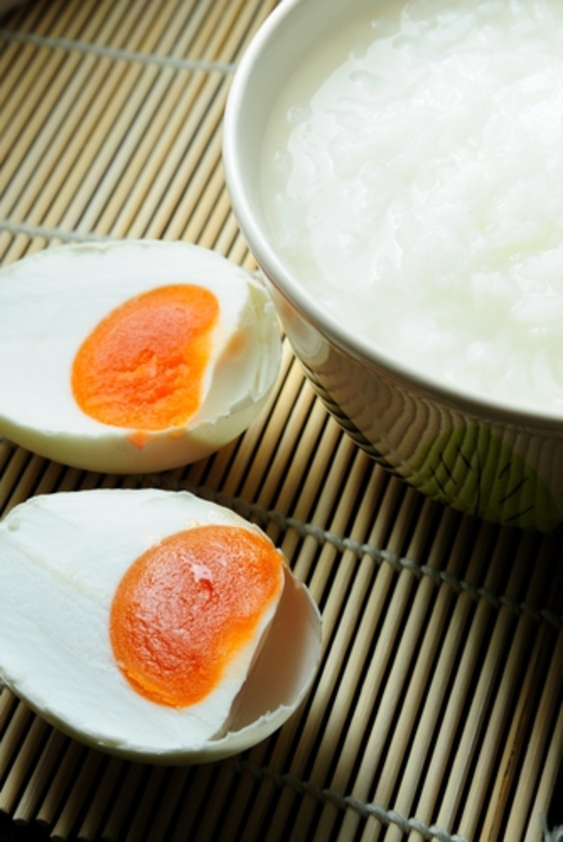 Salted Duck Eggs - delicious with congee. Notice the intensely red-gold of the yolk.  NorGal|Shutterstock.com