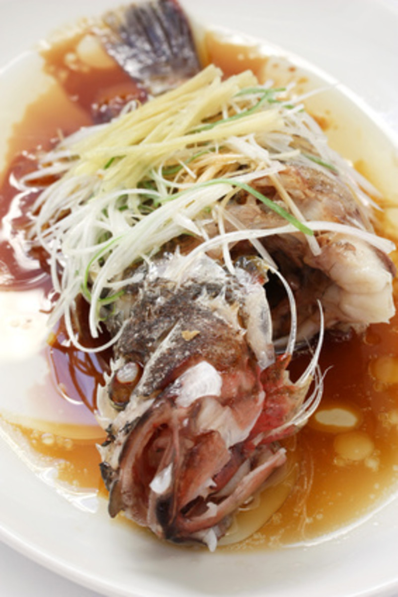 """Clear Steamed"" Fish - classic Cantonese cuisine. Image:   uckyo - Fotolia.com"