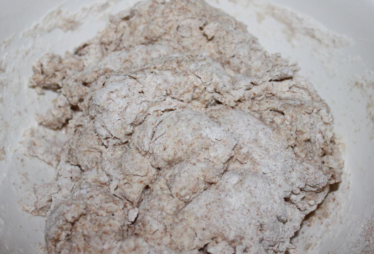 Tip the dough onto a floured surface, you want a soft but not wet dough