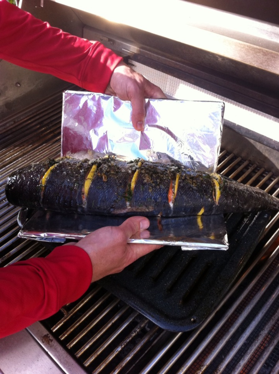 Tinfoil covered paddles for flipping the salmon