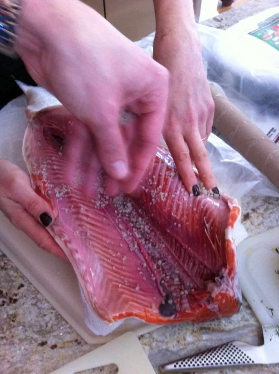 Salt and pepper the inside of the salmon