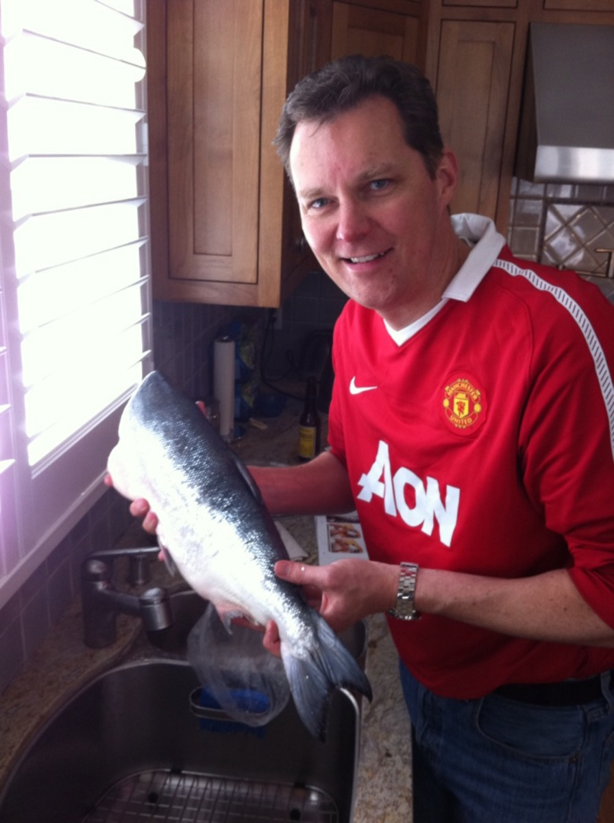 The first step is washing the salmon under cold water and patting it dry on the inside and outside with paper towels