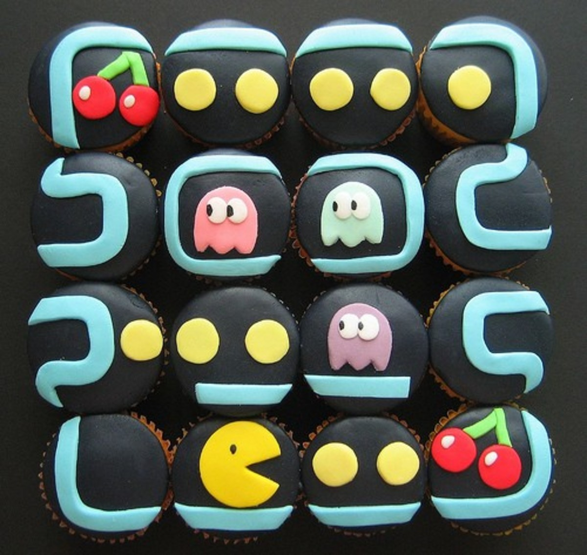 The fondant on these Pac-Man cupcakes is perfect. If you're looking to turn these cupcakes into something a little more suited for couples adding Ms. Pac-Man will definitely do the trick!