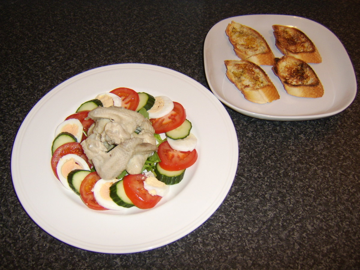 Bruschetta is served on a side plate to accompany the Poached Chicken Wings Summer Salad
